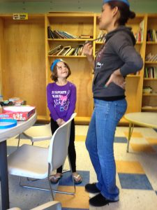 A volunteer, Isabelle, teaches Spanish.